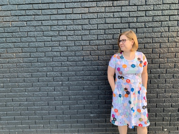 The hex dress in front of a different wall